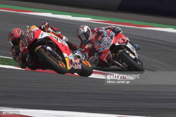 Marc Marquez of Spain and Repsol Honda Team leads Andrea Dovizioso of Italy and Ducati Team during the MotoGP race during the MotoGp of Austria Race...