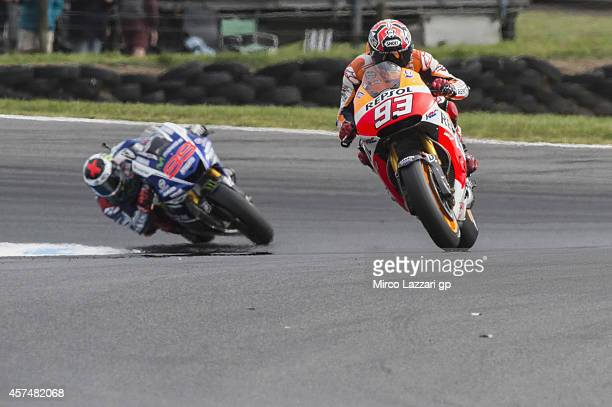 Marc Marquez of Spain and Repsol Honda Team leads Jorge Lorenzo of Spain and Movistar Yamaha MotoGP during the MotoGP race during the 2014 MotoGP of...