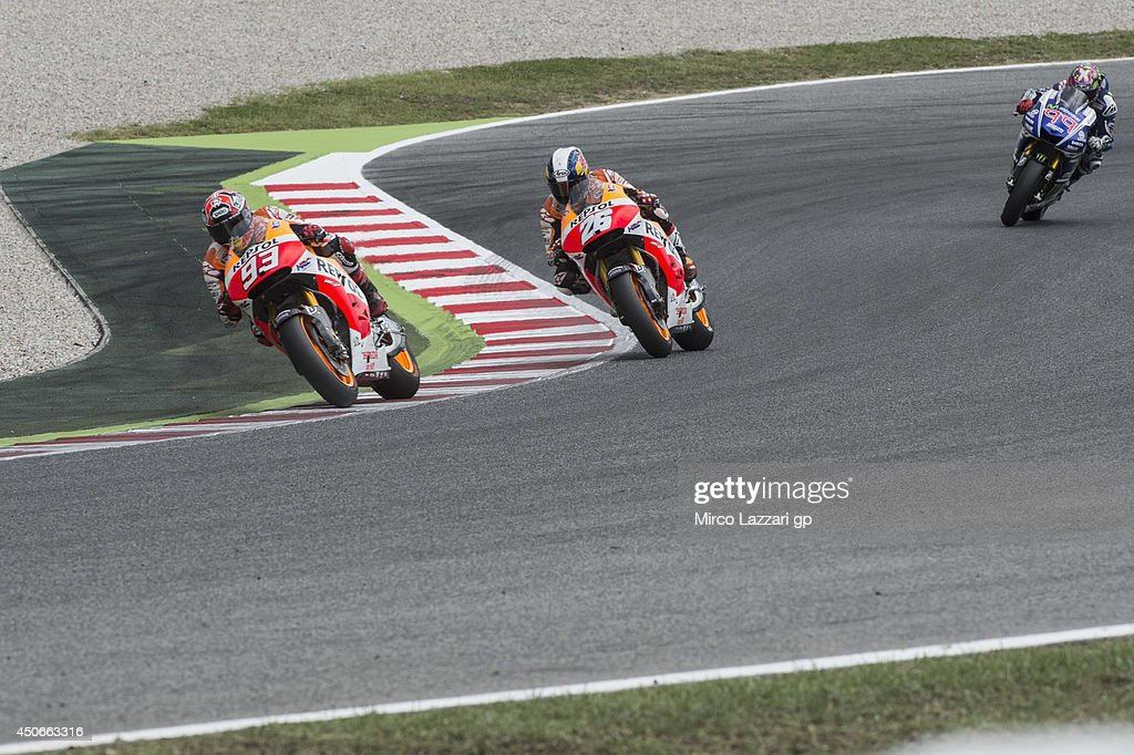 <a gi-track='captionPersonalityLinkClicked' href=/galleries/search?phrase=Marc+Marquez&family=editorial&specificpeople=5409395 ng-click='$event.stopPropagation()'>Marc Marquez</a> of Spain and Repsol Honda Team leads the field during the Moto GP race during the MotoGp of Catalunya - Race at Circuit de Catalunya on June 15, 2014 in Montmelo, Spain.