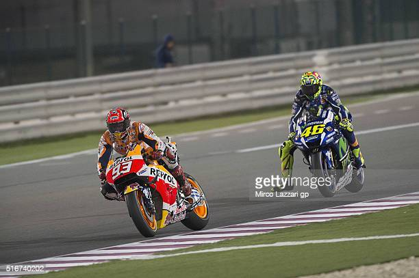 Marc Marquez of Spain and Repsol Honda Team leads Valentino Rossi of Italy and Movistar Yamaha MotoGP during the MotoGP race during the MotoGp of...