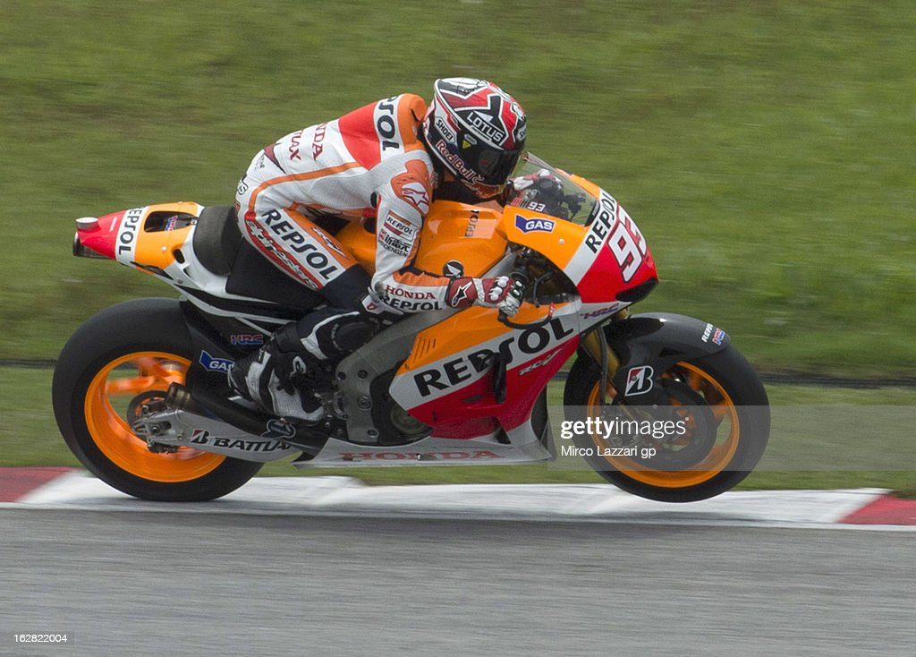 Marc Marquez of Spain and Repsol Honda Team lifts the front wheel during MotoGP Tests in Sepang - Day Three at Sepang Circuit on February 28, 2013 in Kuala Lumpur, Malaysia.