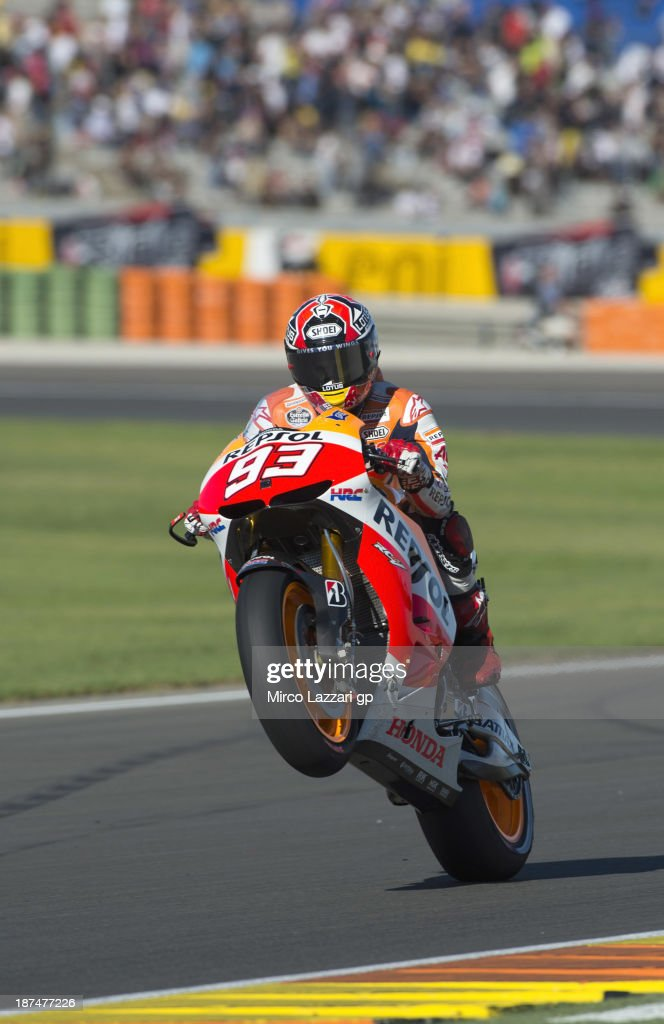 <a gi-track='captionPersonalityLinkClicked' href=/galleries/search?phrase=Marc+Marquez&family=editorial&specificpeople=5409395 ng-click='$event.stopPropagation()'>Marc Marquez</a> of Spain and Repsol Honda Team lifts the front wheel during MotoGP of Valencia - Qualifying at Ricardo Tormo Circuit on November 9, 2013 in Valencia, Spain.