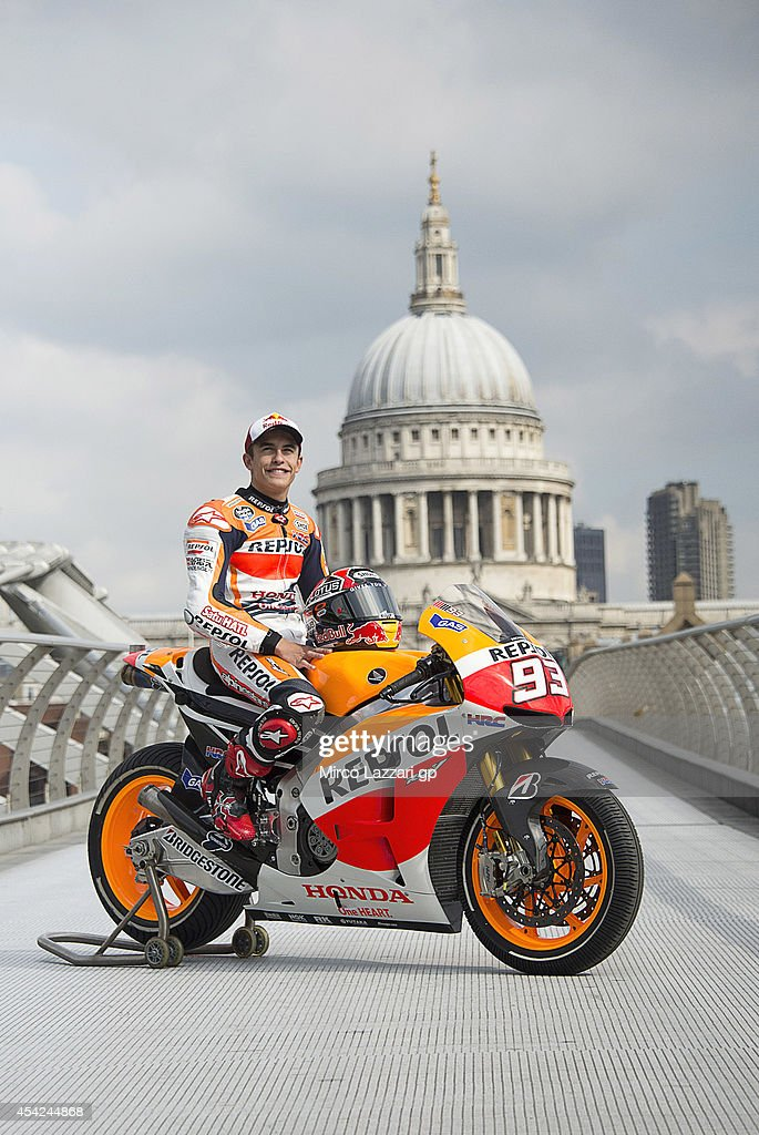 <a gi-track='captionPersonalityLinkClicked' href=/galleries/search?phrase=Marc+Marquez&family=editorial&specificpeople=5409395 ng-click='$event.stopPropagation()'>Marc Marquez</a> of Spain and Repsol Honda Team poses with his bike at a photocall on the Millennium Bridge during previews for the MotoGp Of Great Britain, on August 27, 2014 in London, United Kingdom.