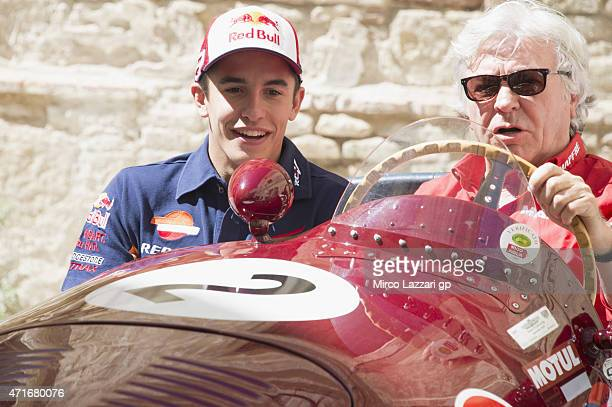 Marc Marquez of Spain and Repsol Honda Team smiles with Angel Nieto of Spain during the preevent 'Exhibition Opening Motorsport Legends 19692015' in...