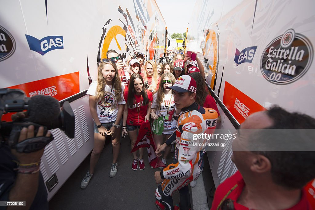 Marc Marquez of Spain and Repsol Honda Team smiles with fans in paddock during the MotoGp of Catalunya Qualifying at Circuit de Catalunya on June 13...