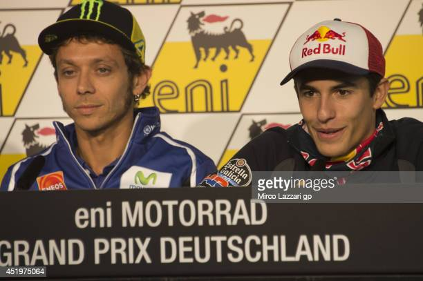 Marc Marquez of Spain and Repsol Honda Team speaks alonsgide Valentino Rossi during the press conference preevent during the MotoGp of Germany...