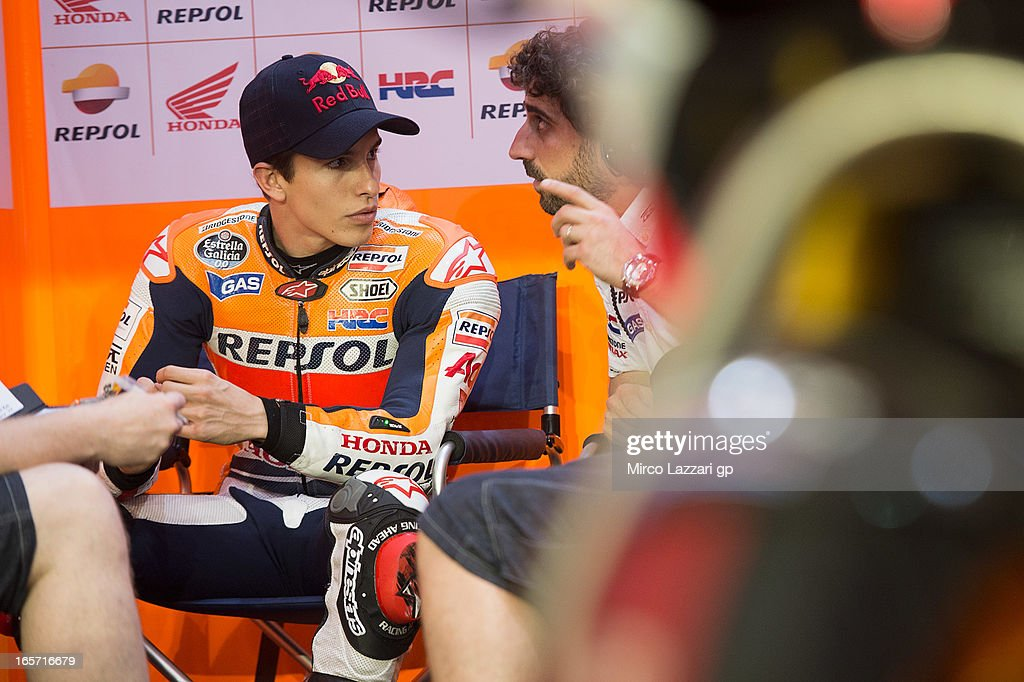<a gi-track='captionPersonalityLinkClicked' href=/galleries/search?phrase=Marc+Marquez&family=editorial&specificpeople=5409395 ng-click='$event.stopPropagation()'>Marc Marquez</a> of Spain and Repsol Honda Team speaks in box during the MotoGp of Qatar - Free Practice at Losail Circuit on April 5, 2013 in Doha, Qatar.