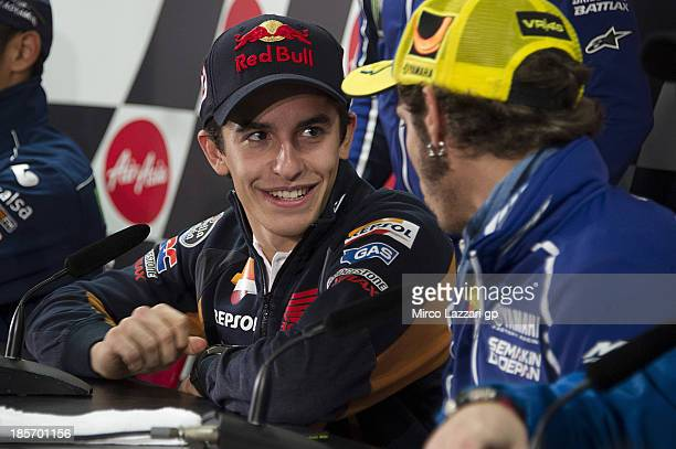 Marc Marquez of Spain and Repsol Honda Team speaks with Valentino Rossi of Italy and Yamaha Factory Racing during the press conference ahead of the...