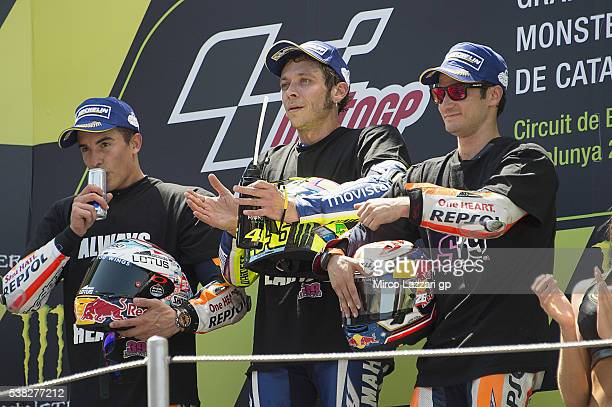 Marc Marquez of Spain and Repsol Honda Team Valentino Rossi of Italy and Movistar Yamaha MotoGP Dani Pedrosa of Spain and Repsol Honda Team celebrate...