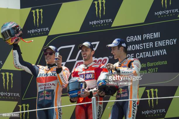 Marc Marquez of Spain and Repsol Honda TeamAndrea Dovizioso of Italy and Ducati Team and Dani Pedrosa of Spain and Repsol Honda Team celebrate on the...