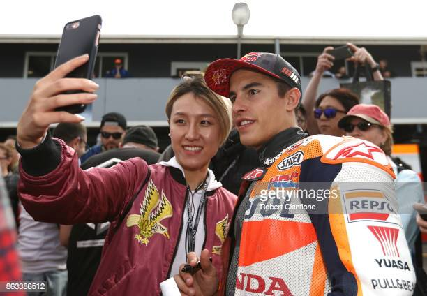 Marc Marquez of Spain and rider of the REPSOL HONDA TEAM Honda poses with fans after free practice for the 2017 MotoGP of Australia at Phillip Island...