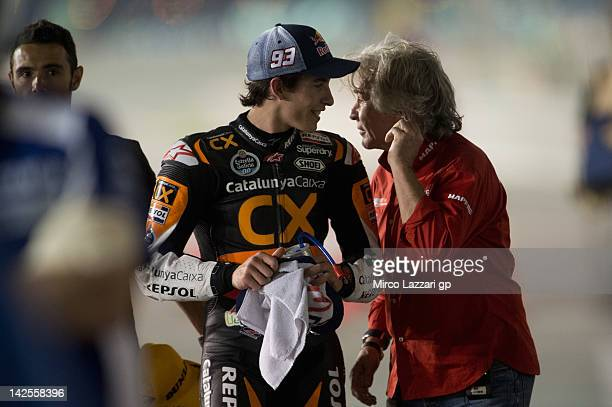 Marc Marquez of Spain and Team Catalunya Caixa Repsol speaks with Angel Nieto of Spain at the end of the qualifying practice of MotoGp of Qatar at...