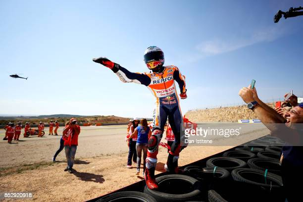 Marc Marquez of Spain and the Repsol Honda Team celebrates victory with his fans by the side of the track after the MotoGP of Aragon at Motorland...