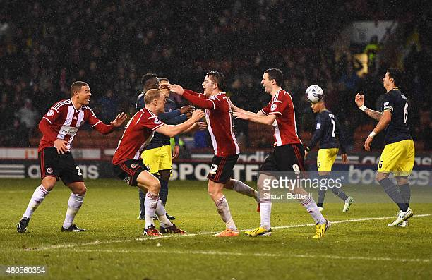 Marc McNulty of Sheffield United celebrates scoring the opening goal with team mates during the Capital One Cup QuarterFinal match between Sheffield...