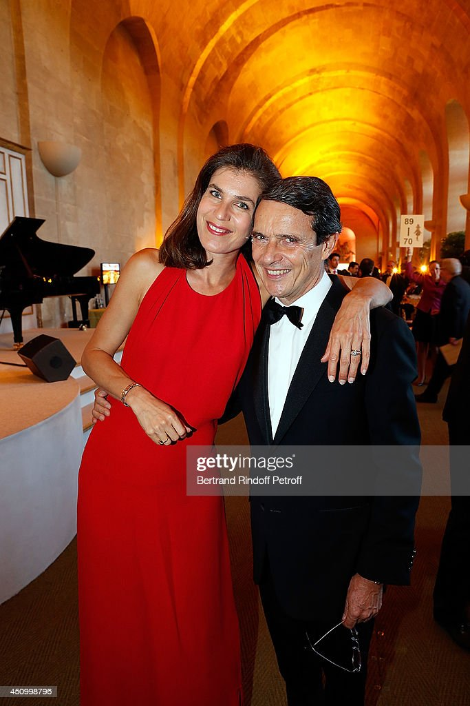 Marc Menesguen and his wife Vanessa attend the L'Oreal Gala Evening 2014 at Chateau de Versailles on June 20, 2014 in Versailles, France.
