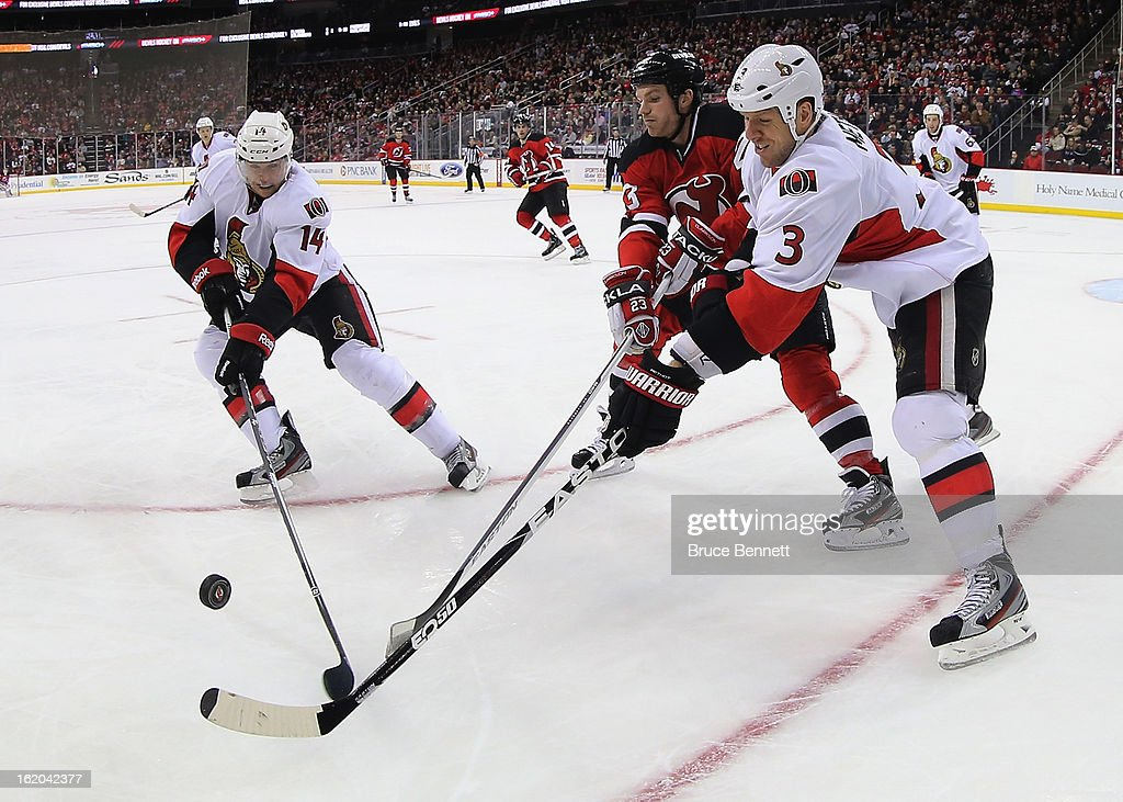 <a gi-track='captionPersonalityLinkClicked' href=/galleries/search?phrase=Marc+Methot&family=editorial&specificpeople=2216900 ng-click='$event.stopPropagation()'>Marc Methot</a> #3 and <a gi-track='captionPersonalityLinkClicked' href=/galleries/search?phrase=Colin+Greening&family=editorial&specificpeople=7183741 ng-click='$event.stopPropagation()'>Colin Greening</a> #14 of the Ottawa Senators pusue the puck along with David Clarkson #23 of the New Jersey Devils at the Prudential Center on February 18, 2013 in Newark, New Jersey.