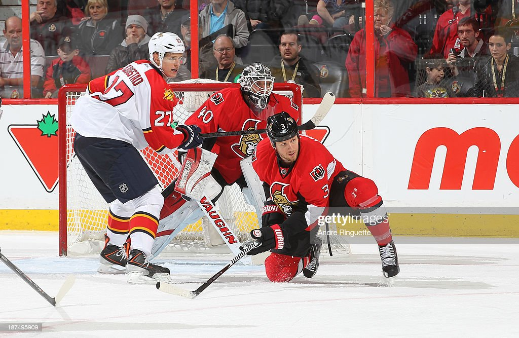<a gi-track='captionPersonalityLinkClicked' href=/galleries/search?phrase=Marc+Methot&family=editorial&specificpeople=2216900 ng-click='$event.stopPropagation()'>Marc Methot</a> #3 and <a gi-track='captionPersonalityLinkClicked' href=/galleries/search?phrase=Robin+Lehner&family=editorial&specificpeople=5894610 ng-click='$event.stopPropagation()'>Robin Lehner</a> #40 of the Ottawa Senators defend their net against <a gi-track='captionPersonalityLinkClicked' href=/galleries/search?phrase=Nick+Bjugstad&family=editorial&specificpeople=7029343 ng-click='$event.stopPropagation()'>Nick Bjugstad</a> #27 of the Florida Panthers at Canadian Tire Centre on November 9, 2013 in Ottawa, Ontario, Canada.