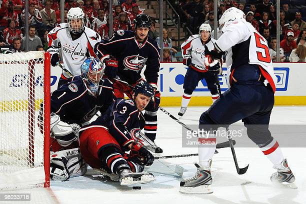 Marc Methot helps goaltender Steve Mason both of the Columbus Blue Jackets stops puck before Mike Green of the Washington Capitals is able to get to...