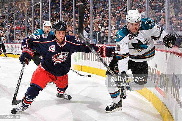 Marc Methot of the Columbus Blue Jackets and Patrick Marleau of the San Jose Sharks chase after a loose puck during the second period on February 9...