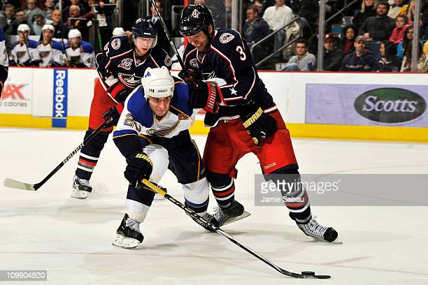 Marc Methot of the Columbus Blue Jackets checks Alexander Steen of the St Louis Blues during the second period on March 9 2011 at Nationwide Arena in...