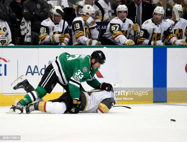 Marc Methot of the Dallas Stars lands on top of William Karlsson of the Vegas Golden Knights during the season opening game at American Airlines...