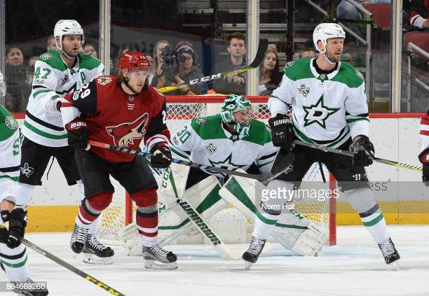Marc Methot of the Dallas Stars looks for the puck while teammate Alexander Radulov battles for position in front of goaltender Ben Bishop with Mario...