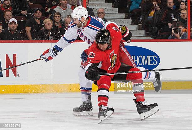 Marc Methot of the Ottawa Senators and Rick Nash of the New York Rangers collide during an NHL game at Canadian Tire Centre on November 14 2015 in...