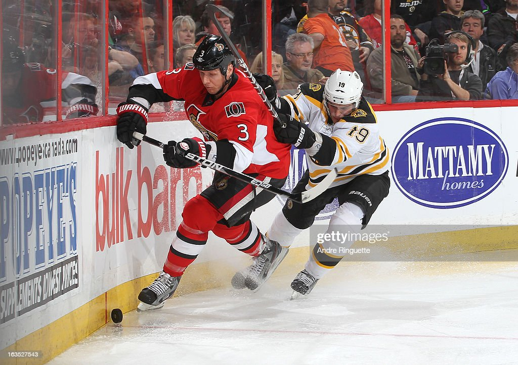 Marc Methot #3 of the Ottawa Senators and Tyler Seguin #19 of the Boston Bruins battle for the loose puck along the boards on March 11, 2013 at Scotiabank Place in Ottawa, Ontario, Canada.