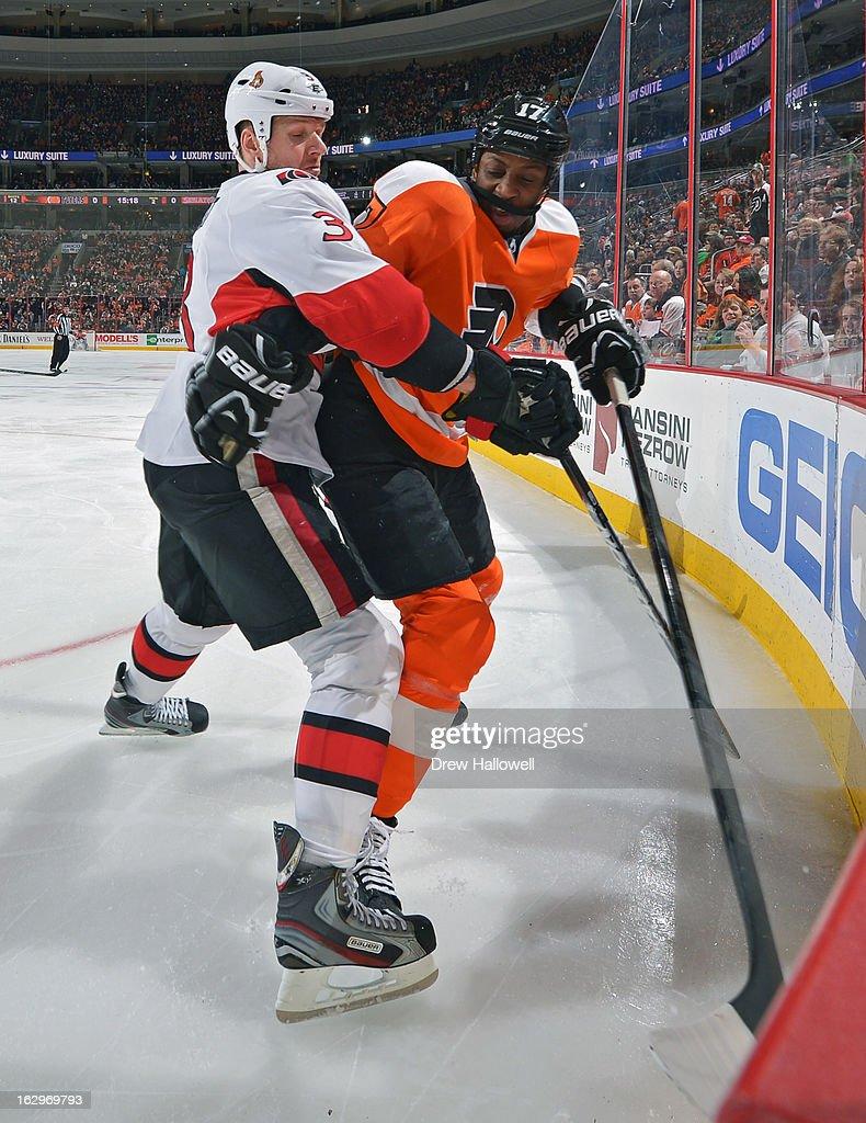 Marc Methot #3 of the Ottawa Senators and Wayne Simmonds #17 of the Philadelphia Flyers battle in the corner at the Wells Fargo Center on March 2, 2013 in Philadelphia, Pennsylvania.