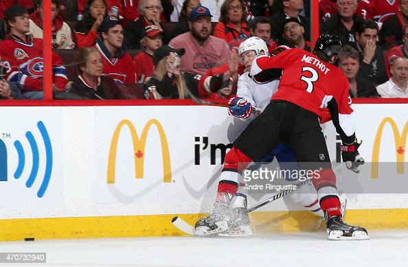 Marc Methot of the Ottawa Senators bodychecks Brendan Gallagher of the Montreal Canadiens into the boards in Game Four of the Eastern Conference...