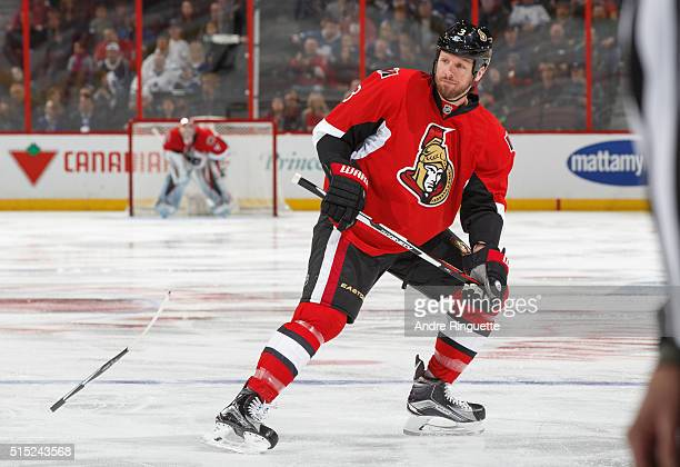 Marc Methot of the Ottawa Senators breaks his stick on the follow through of a slapshot against the Toronto Maple Leafs at Canadian Tire Centre on...