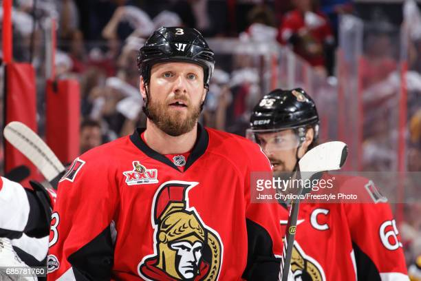 Marc Methot of the Ottawa Senators celebrates a first period goal by teammate Zack Smith with Erik Karlsson against the Pittsburgh Penguins in Game...