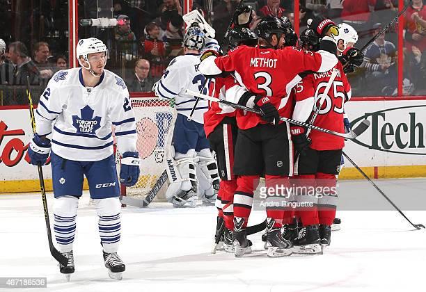 Marc Methot of the Ottawa Senators celebrates a first period goal with teammates David Legwand and Erik Karlsson as Zach Sill of the Toronto Maple...