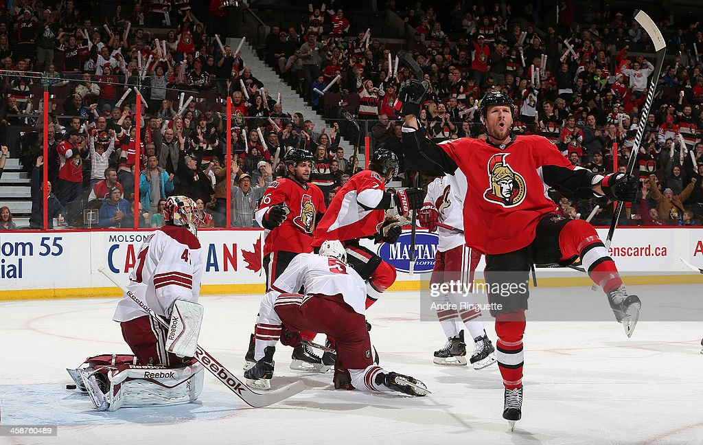 Marc Methot of the Ottawa Senators celebrates his first period powerplay goal against Mike Smith and Connor Murphy of the Phoenix Coyotes with...