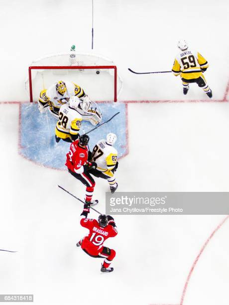 Marc Methot of the Ottawa Senators celebrates his first period goal with teammate Derick Brassard as MarcAndre Fleury Sidney Crosby Ian Cole and Jake...