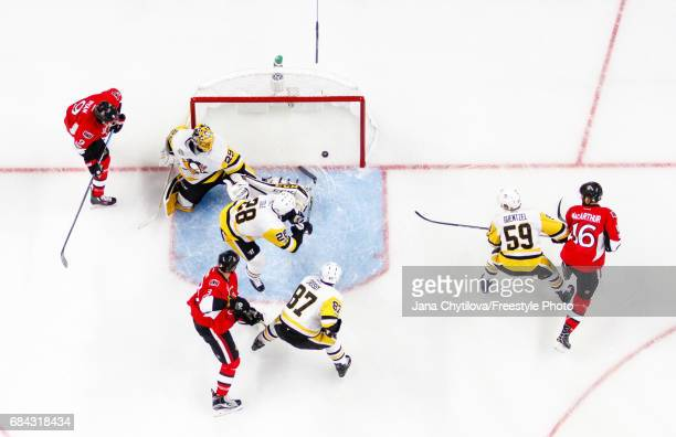 Marc Methot of the Ottawa Senators celebrates his first period goal with teammates Bobby Ryan and Clarke MacArthur as MarcAndre Fleury Sidney Crosby...