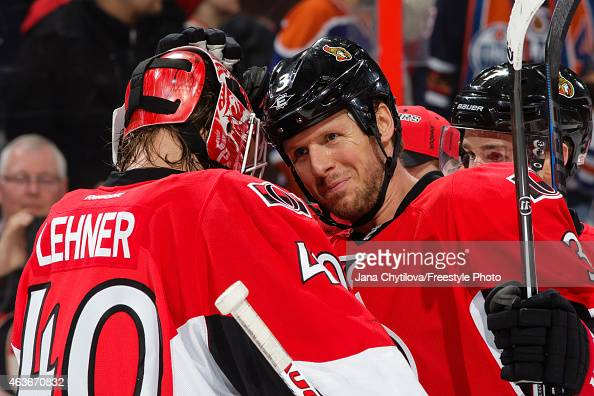 Marc Methot of the Ottawa Senators celebrates with team mate Robin Lehner their win against the Edmonton Oilers at Canadian Tire Centre on February...