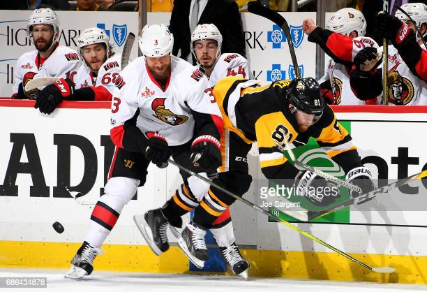Marc Methot of the Ottawa Senators checks Phil Kessel of the Pittsburgh Penguins in Game Five of the Eastern Conference Final during the 2017 NHL...
