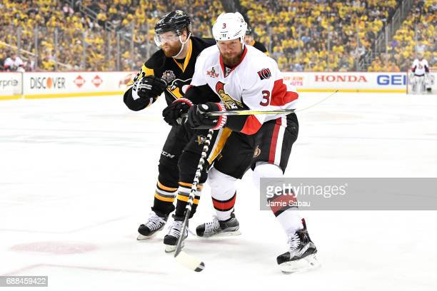 Marc Methot of the Ottawa Senators collides with Phil Kessel of the Pittsburgh Penguins during the first period in Game Seven of the Eastern...