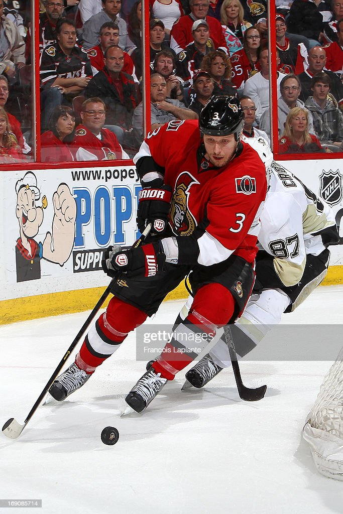 <a gi-track='captionPersonalityLinkClicked' href=/galleries/search?phrase=Marc+Methot&family=editorial&specificpeople=2216900 ng-click='$event.stopPropagation()'>Marc Methot</a> #3 of the Ottawa Senators controls the puck against <a gi-track='captionPersonalityLinkClicked' href=/galleries/search?phrase=Sidney+Crosby&family=editorial&specificpeople=212781 ng-click='$event.stopPropagation()'>Sidney Crosby</a> #87 of the Pittsburgh Penguins in Game Three of the Eastern Conference Semifinals during the 2013 NHL Stanley Cup Playoffs at Scotiabank Place on May 19, 2013 in Ottawa, Ontario, Canada.
