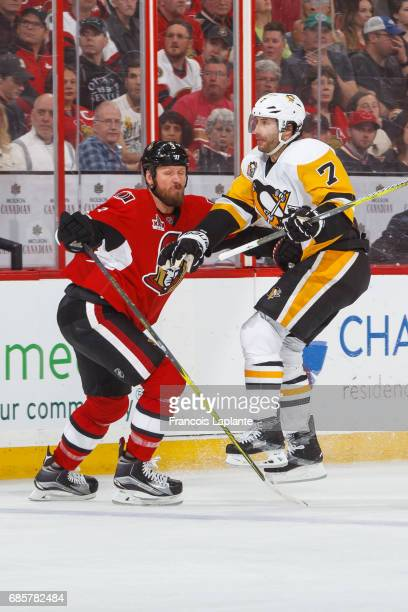Marc Methot of the Ottawa Senators defends against Matt Cullen of the Pittsburgh Penguins in Game Three of the Eastern Conference Final during the...