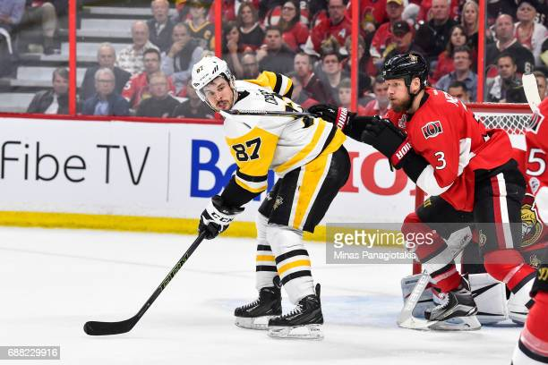 Marc Methot of the Ottawa Senators defends against Sidney Crosby of the Pittsburgh Penguins in Game Six of the Eastern Conference Final during the...