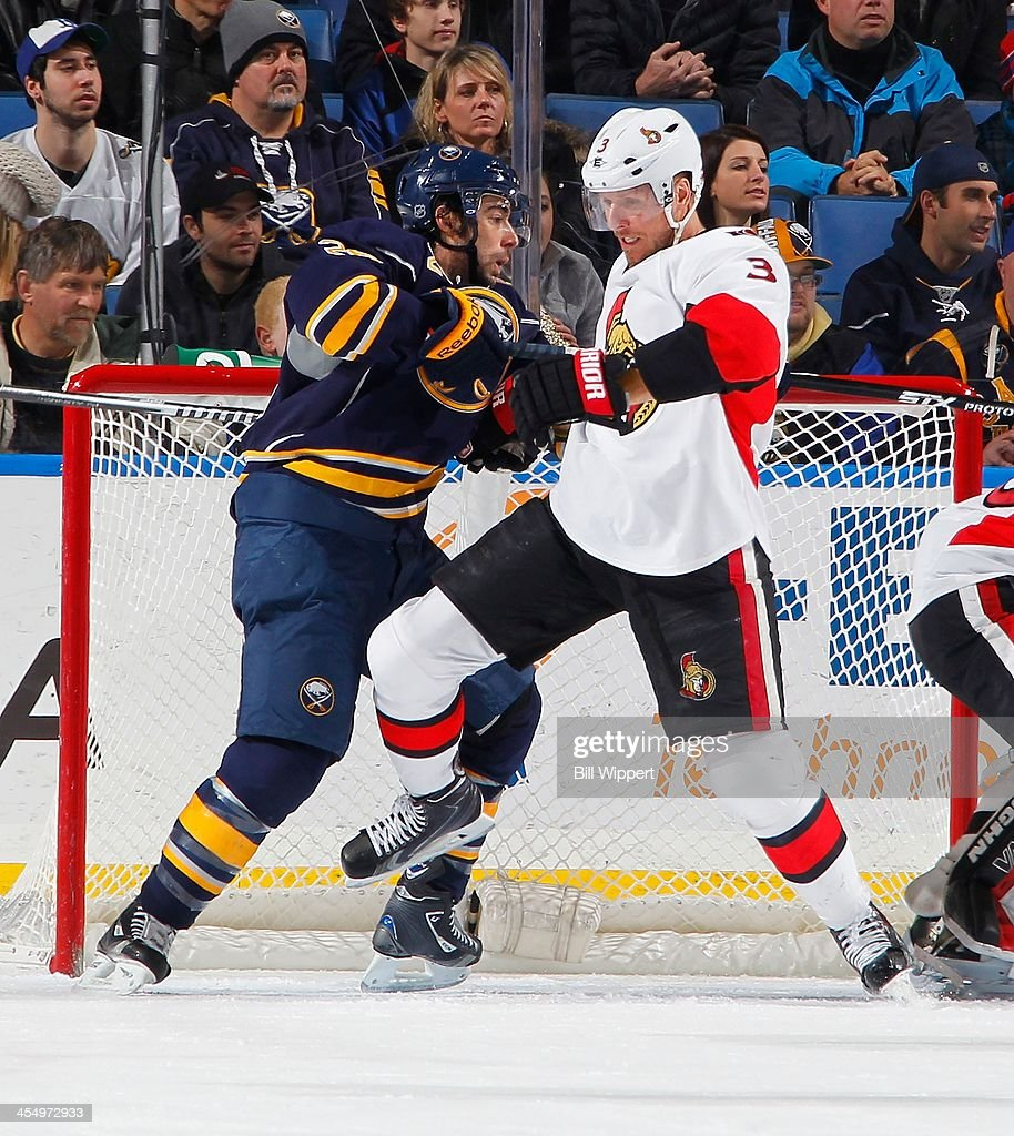 Marc Methot #3 of the Ottawa Senators defends Matt Moulson #26 of the Buffalo Sabres in front of the net during the second period on December 10, 2013 at the First Niagara Center in Buffalo, New York.