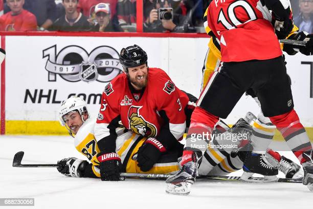 Marc Methot of the Ottawa Senators falls on top of Sidney Crosby of the Pittsburgh Penguins in Game Six of the Eastern Conference Final during the...