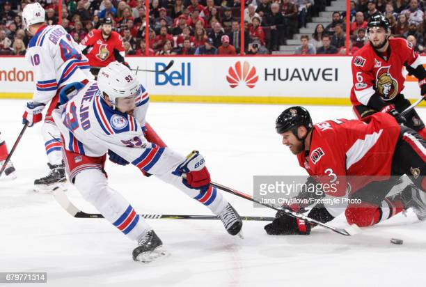 Marc Methot of the Ottawa Senators falls to the ice as he defends against Mika Zibanejad of the New York Rangers in Game Five of the Eastern...