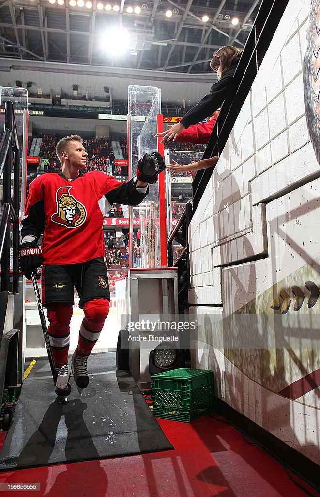 Marc Methot #3 of the Ottawa Senators high-fives fans as he walks down the players' tunnel after warmup prior to playing against the Florida Panthers on January 21, 2013 at Scotiabank Place in Ottawa, Ontario, Canada.