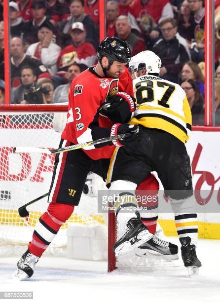 Marc Methot of the Ottawa Senators hits Sidney Crosby of the Pittsburgh Penguins during the second period in Game Six of the Eastern Conference Final...