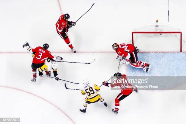 Marc Methot of the Ottawa Senators holds Sidney Crosby of the Pittsburgh Penguins as Zack Smith Tom Pyatt and Craig Anderson of the Senators and Jake...