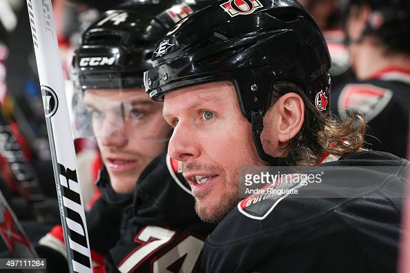 Marc Methot of the Ottawa Senators looks on from the bench against the Vancouver Canucks at Canadian Tire Centre on November 12 2015 in Ottawa...