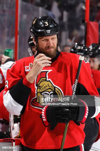 Marc Methot of the Ottawa Senators reacts after using smelling salts against the Pittsburgh Penguins in Game Four of the Eastern Conference Final...